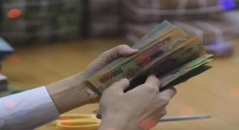 Việt Nam giảm giá trị tiền Đồng để thúc đẩy tăng trưởng